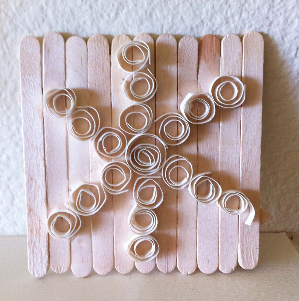 kids art project snowflake quilling