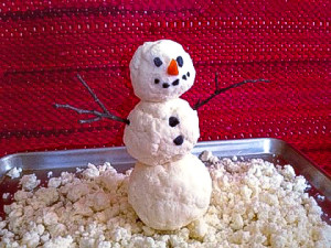 Make an Indoor Snowman with pretend snow
